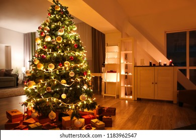 Beautiful Christmas tree with gifts in living room