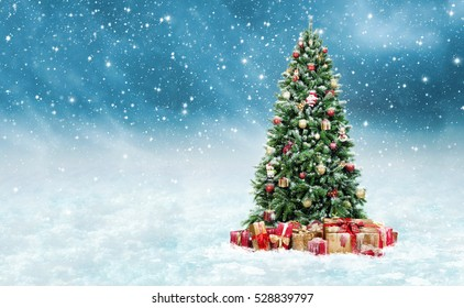 Beautiful christmas tree with golden and red present boxes in a snowy winter landscape