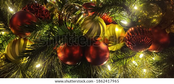 Beautiful Christmas tree ornaments. You'll love its bountiful mix of berries and glitter ornaments winding up your stairwell or the fireplace.