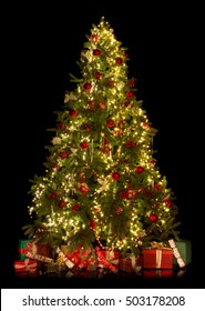 Beautiful christmas tree with presents isolated on black