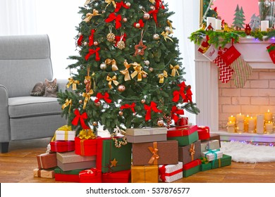 Beautiful Christmas tree with presents in living room