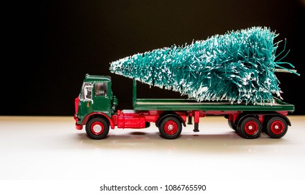 A beautiful Christmas tree ready for delivery on the back of a long truck.