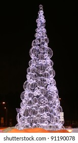 Beautiful Christmas tree is shining and sparkling in the night with wonderful colors in Riga, Latvia