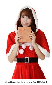 Beautiful Christmas woman of Asian holding gift box and smiling over white.