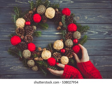 Beautiful Christmas wreath in woman hands. Preparation for holidays concept