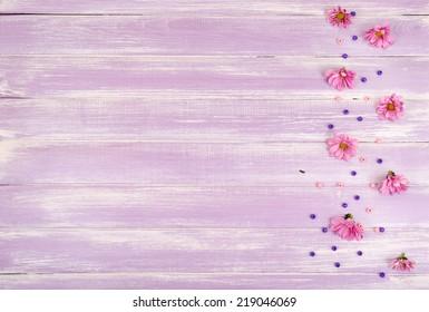 beautiful chrysanthemum flowers on purple wooden background