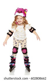 Beautiful, chubby little girl with long, blond,curly hair.Girl riding roller skates in protective gear.Isolated on white background.