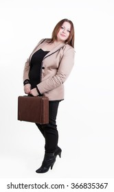 beautiful chubby woman in a brown jacket with a leather suitcase standing on a white background