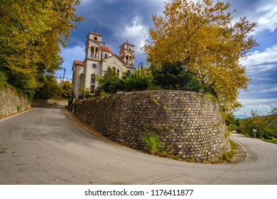 Beautiful church of Agios Dimitrios Village in Pelion mountain during Autumn season. It is located at a lush green slope of the mountain at an altitude of 300m. Magnesia - Greece