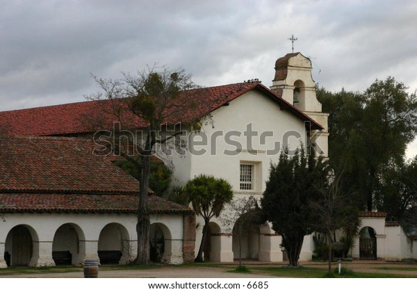 beautiful church with arches and trees