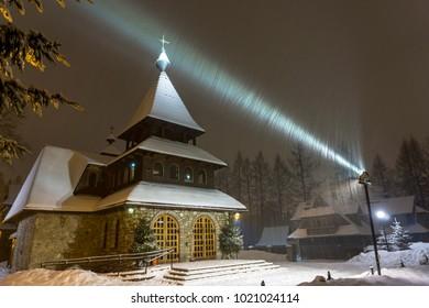 A beautiful church by night in a winter scenery. Bystre. Zakopane.