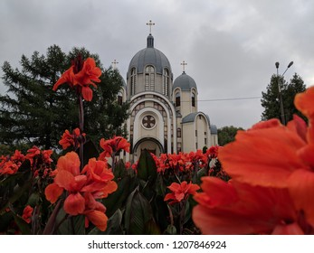 beautiful church with beautiful red flowers on an overcast day