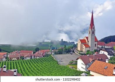 Beautiful church in small tirolean village on summer, italian Alps