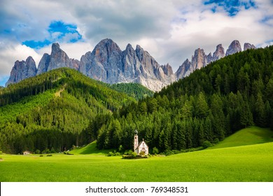 Beautiful Church of St John of Nepomuk (Chiesetta di San Giovanni) in Ranui, Val di Funes, Dolomites, Italy