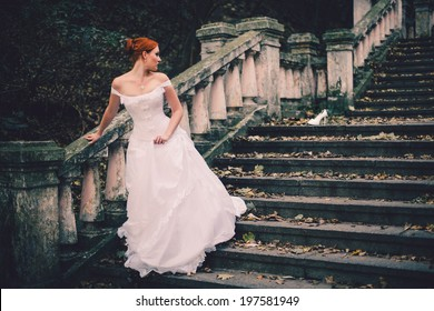 beautiful cinderella bride on stairs