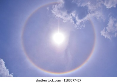 The beautiful circular Halo sky, white and rainbow colors rounded the sun. The optical phenomenon.