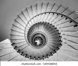 Beautiful circular staircase in old house, snail geometry, black and white