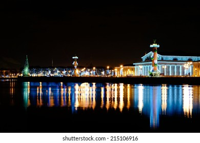 The beautiful city adorned with Christmas and New Year lights. Holidays lights of Winter in St. Petersburg. Spit of Vasilievsky Island.  New Year's holidays and Christmas tree.