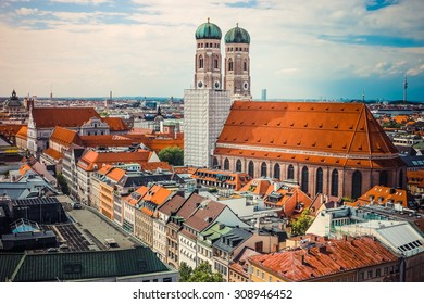 beautiful city centre view of Marienplatz, New Town Hall (Neues Rathaus), Glockenspiel, Frauenkirche with sky in Munich, (Bavaria). Retro and vintage foto. the sun summer day and blue sky with clouds