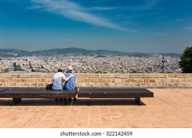 Beautiful city landscape in Barcelona and unidentified couple in summer time