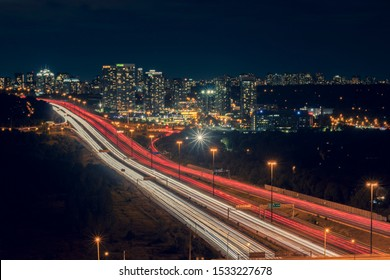 Beautiful City lights, Cityscape, Night Long Exposure from DVP Car fast, Speed Traffic on 401 Highway Toronto Canada with Cityscape on Yonge Street