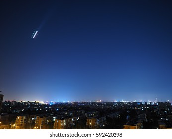 The beautiful city night sky with the twinkle stars and flying airplane