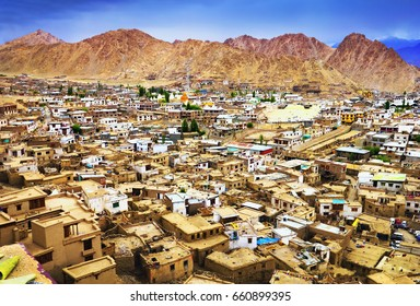 Beautiful city scape: lot of old traditional tibetan houses and central asian urban infrastructure, view from Leh Palace hill in Leh - the capital of Ladakh, Himalayas, Jammu & Kashmir, Northern India