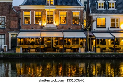 beautiful city scenery at night with lighted buildings and the water reflecting the lights, Popular dutch city Alphen aan den Rijn, The Netherlands