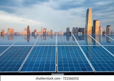 beautiful city twilight reflected on the solar energy panels