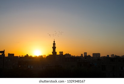 Beautiful city view during the sundown. Sundown in Cairo. Sunset in Cairo. Cairo at the end of the day. Panorama. Copy space.