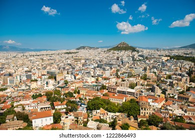 Beautiful city view on Athens streets and  Mount Lycabettus from the Acropolis hill.