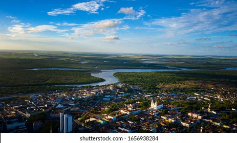 Beautiful cityscape aerial view of downtown João Pessoa with gorgeous cathedrals, rivers, and fields in the background located in Brazil.