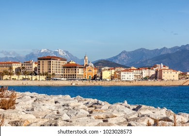 Beautiful cityscape, Ajaccio is the capital of Corsica. City on a background of snowy mountains and blue sky
