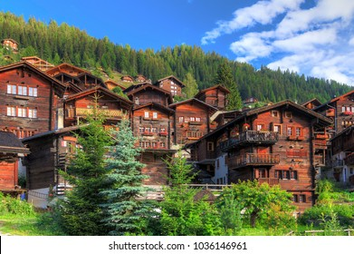Beautiful cityscape of the alpine village Grimentz, Switzerland, with traditional wooden houses in summer