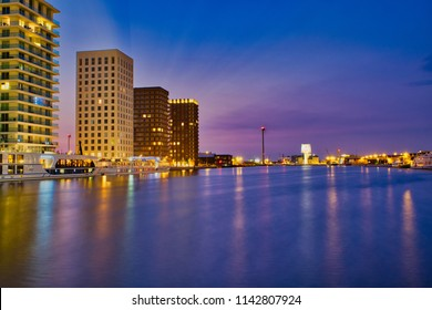 A beautiful cityscape of Antwerp. The 'Kattendijkdok' reflects the beautiful 'Havenhuis'. Wonderful colors and lights after sunset. Antwerp at his best, a destination for many tourists.
