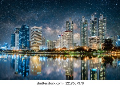 Beautiful cityscape in business district at night with milky way