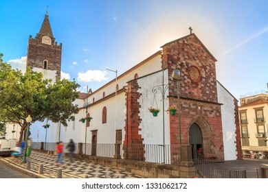 Beautiful cityscape of the Cathedral of Our Lady of the Assumption (Portuguese, e Catedral de Nossa Senhora da Assuncao) in Se, Funchal, Madeira, Portugal, on a summer day with blue sky