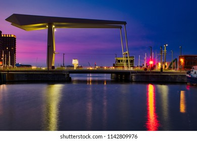 A beautiful cityscape of the city of Antwerp. The new Londonbridge in front of the 'Havenhuis'. Colorful reflections and sky. Near 'Het Eilandje' in the north of Antwerp.