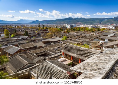 Beautiful cityscape of Lijiang ancient town with view of tiled roofs of ancient shophouses, Yunan, China.