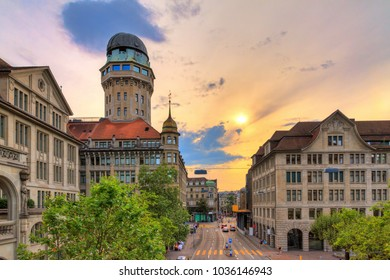 Beautiful cityscape looking towards the Urania Sternwarte observatory telescope in Zurich, Switzerland, with a beautiful sunset sky in summer