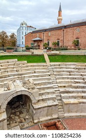 Beautiful cityscape of the public Dzhumaya square in Plovdiv, Bulgaria, with the sfendona of the ruins of the Roman Stadium of Philipopolis and the ancient Ottoman Mosque