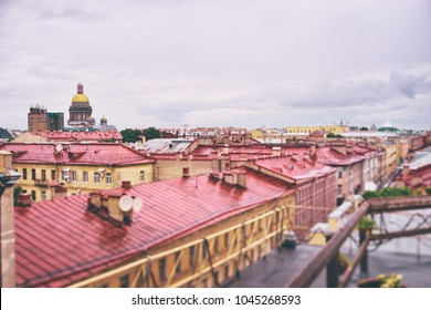 Beautiful cityscape. Rainy day at Saint-Petersburg, Russia. Rooftop view on old buildings and St Isaac Cathedral.