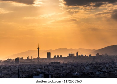Beautiful cityscape of Tehran-Iran at sunset with Milad tower and several buildings in frame.