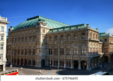 The beautiful cityscape of Vienna's state opera house with empty street in the foreground with nice blue sky during the summer