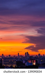 Beautiful Cityscape view of Bangkok's business district and a residential neighborhood at dusk.