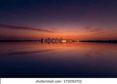 Beautiful cityscape view of Manama City. Colourful and dramatic sky. taken from Nurana Island, Bahrain. taken on November 2019.