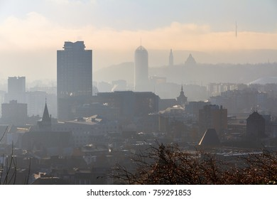Beautiful cityscape view of the skyline of Liege, Belgium, with skyscrapers on a sunny and hazy winter day seen from the top of the Montagne de Bueren