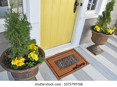 Beautiful Classic beige zute and black rubber border Outdoor Doormat with welcome text outside home with yellow flower pots