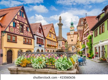 Beautiful classic postcard view of the famous historic town of Rothenburg ob der Tauber on a sunny day with blue sky and clouds in summer, Franconia, Bavaria, Germany