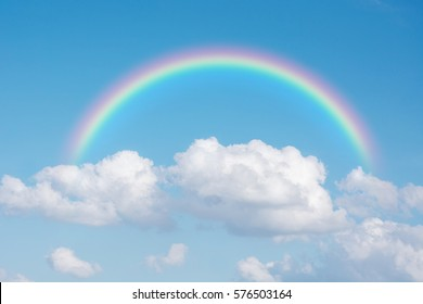 Beautiful Classic Rainbow Across In The Blue Sky After The Rain, Rainbow Is A Natural Phenomenon That Occurs After Rain, Consists Of Purple, Indigo Blue, Blue, Green, Yellow, Orange And Red.